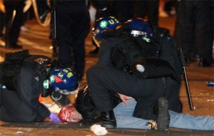 Injured fan attended to by police after violence erupts between West Ham and Millwall fans in 2009.